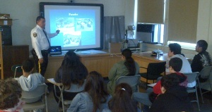 Bronx HS for Law & Community Service students listen to an MTA classroom presentation.