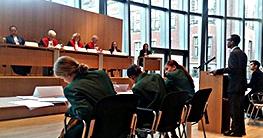 Alexter Thompson, Hillcrest HS, argues for the NYC prosecution as Pretoria's defense team prepares their arguments.