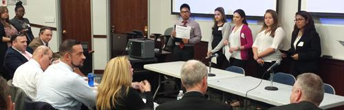 William Cullen Bryant HS students answer judges' questions after presenting their debate topic arguments.